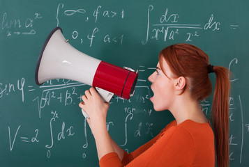 Student Screaming On Megaphone Against Blackboard
