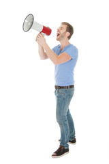 Full Length Of Man Screaming Into Megaphone