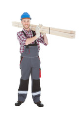 Manual Worker Carrying Wooden Planks