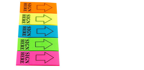 Colorful stick it SIGN HERE arrow tag over white background