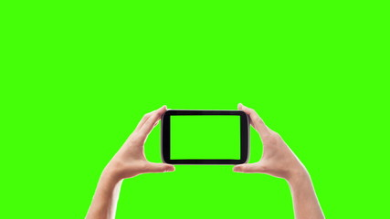 electronic tablet on a green background