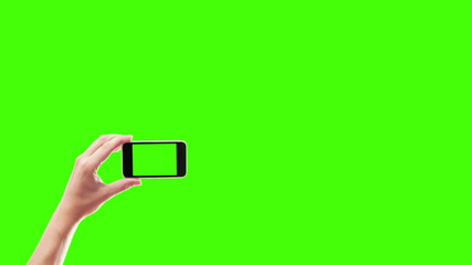 hands holding smart phone on a green background