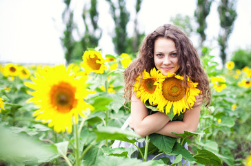 The girl among sunflowers