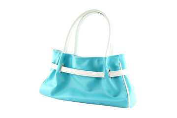 Pale blue handbag of texture leather isolated on white.