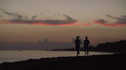 Couple jogging on the beach, slow motion shot at 240fps