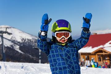 Smiling kid in helmet portrait with hands up