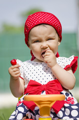 Toddler eating an cherry