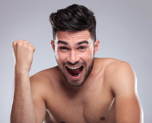 topless young man screaming of joy