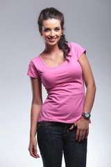 smiling young casual woman standing in studio