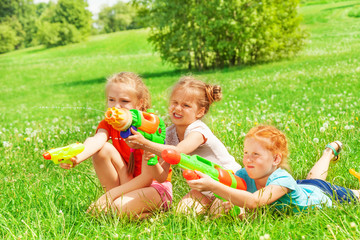 Three beautiful girls playing on a grass