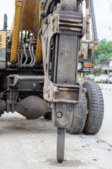 Head Hammers backhoe in construction