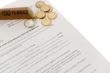 Divorce Form With Roll Of Pennies And Single Wedding Ring