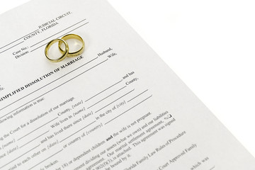 Divorce Form With Pair Of Wedding Rings