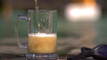 Beer pour to the glass, steadycam shot, slow motion shot