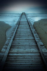 View of a long wooden pier on the sea with a vintage effect