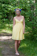 Young beautiful lady in yellow dress in