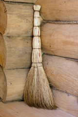 broom in a corner of a wooden house