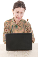 portrait of young woman in shirt sitting and using laptop
