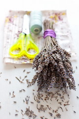 Dried lavender bouquet, scissors and cloth on the white