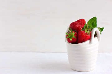 Strawberries in ceramic basket