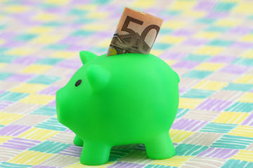 Piggy bank with banknote sticking out