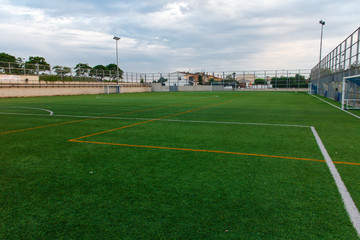 football amateur stadium with green grass