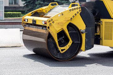 Road rollers paving a road