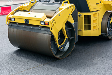 Road roller at work of road repairing