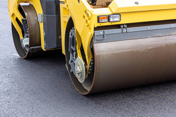 Steamroller at asphalt pavement works