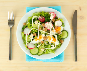Fresh mixed salad with eggs, salad leaves and other vegetables,
