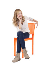 young girl sitting on chair