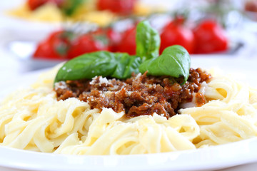 pasta bolognese with basil and cheese