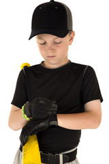Young boy baseball player fixing his batting glove