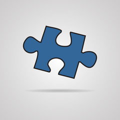 Closeup of jigsaw puzzle piece isolated on grey