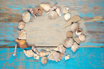 Marine items on a wooden boards on sandy background