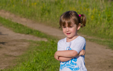 Little girl on walk in the field