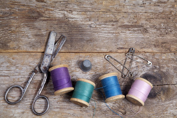 Vintage Background with sewing tools and colored tape