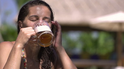 Woman drinking beer, steadycam shot, slow motion shot