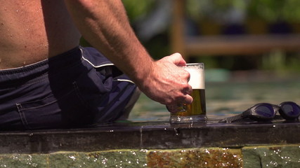 Man put beer down, steadycam shot, slow motion shot at 240fps