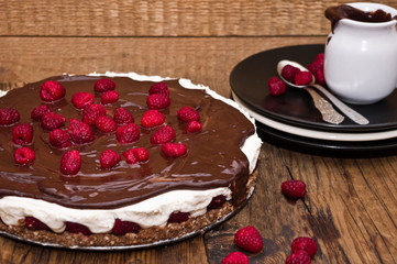 Unbaked cheesecake with chocolate and raspberries