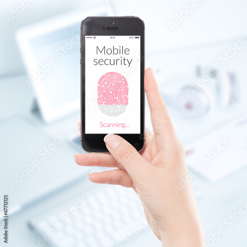 Leinwandbild Motiv Close-up mobile security smartphone fingerprint scanning