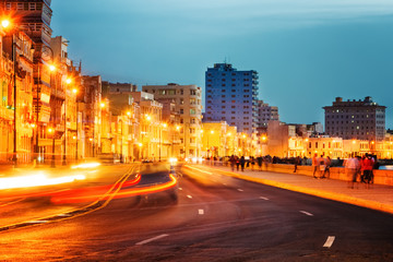 Sunset in Old Havana with  the street lights of El Malecon