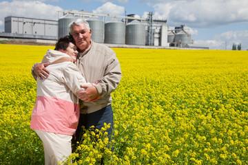 Elderly couple on rapeseed field