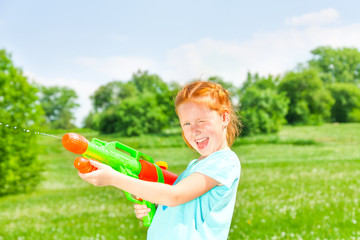 Nice girl with a water gun