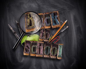 School concept with tools and blackboard
