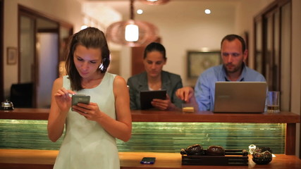 Businesspeople working at night on modern technology in pub