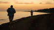 People jogging on pathway at sunrise in exotic place