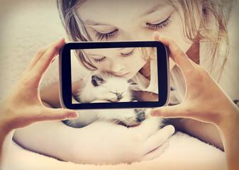 child and kitten