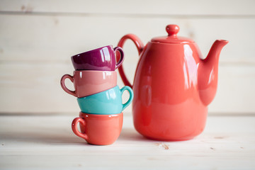 colorful tea set on a wooden background