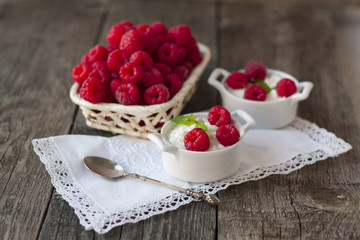 dessert from cottage cheese and raspberries on a white napkin on